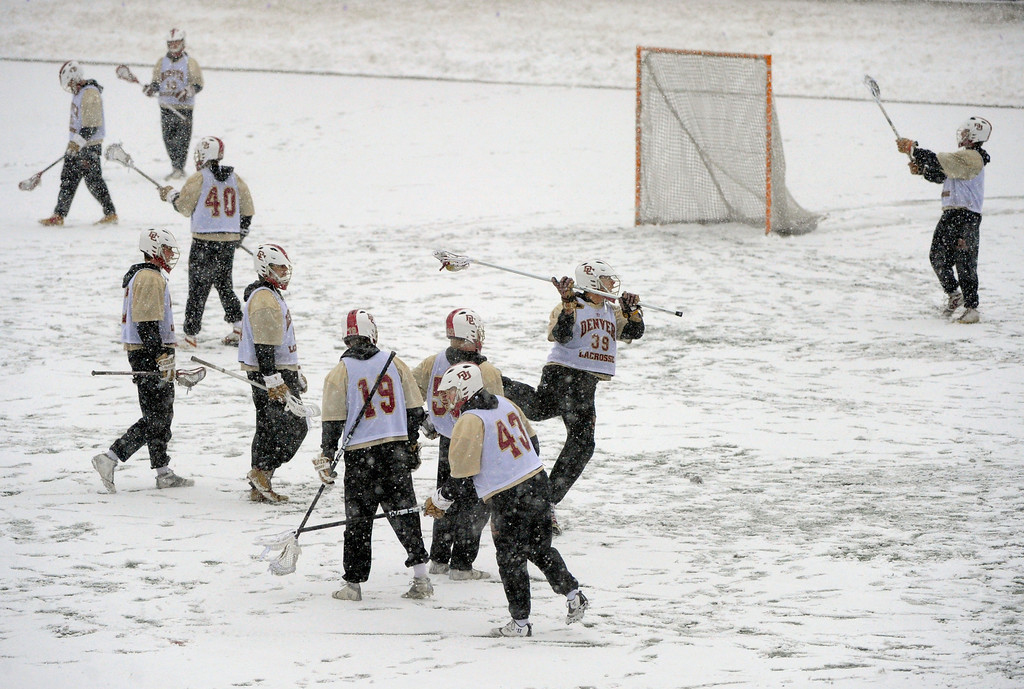 . DENVER, CO. - FEBRUARY 20:  The University of Denver lacrosse team practiced as the snow fell Wednesday evening, February 20, 2013. The Pioneers are hoping for better weather for the home opener. (Photo By Karl Gehring/The Denver Post)