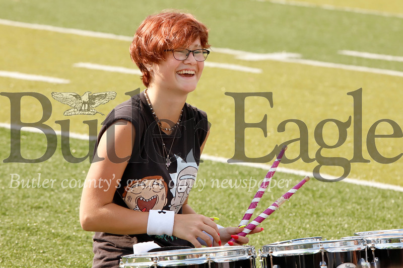 Emily Ehrat (CHECK SPELLING) smiles after hitting the last beat to a song at band Karns  City band practice Tuesday. Seb Foltz/Butler Eagle 08/20/19