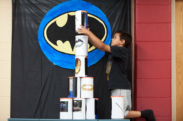 06/28/18 Wesley Bunnell | Staff Adam Tartt, age 9, stacks cans at one of the carnival games at the Tween Time Olympics at the New Britain Public Library on Thursday afternoon. The event is designed to bridge the gap from youth to teen events in the library.