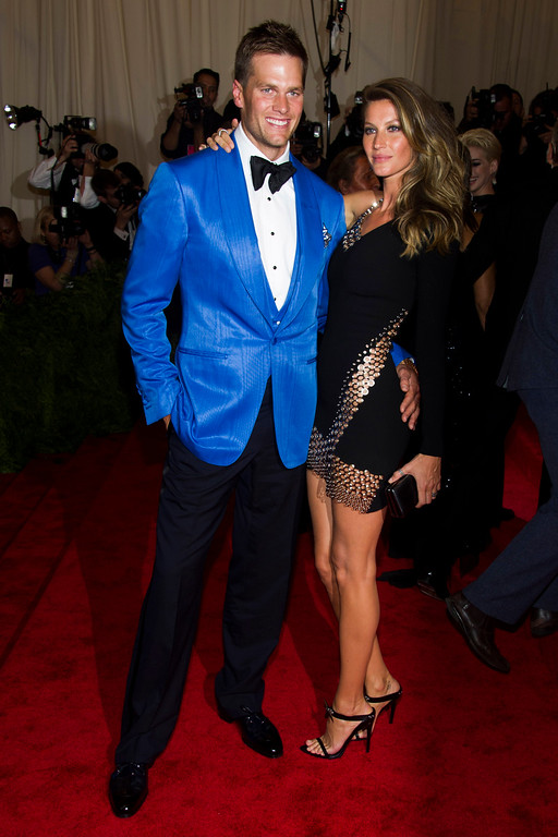 """. Tom Brady and Gisele Bundchen attend The Metropolitan Museum of Art\'s Costume Institute benefit celebrating \""""PUNK: Chaos to Couture\"""" on Monday, May 6, 2013 in New York. (Photo by Charles Sykes/Invision/AP)"""