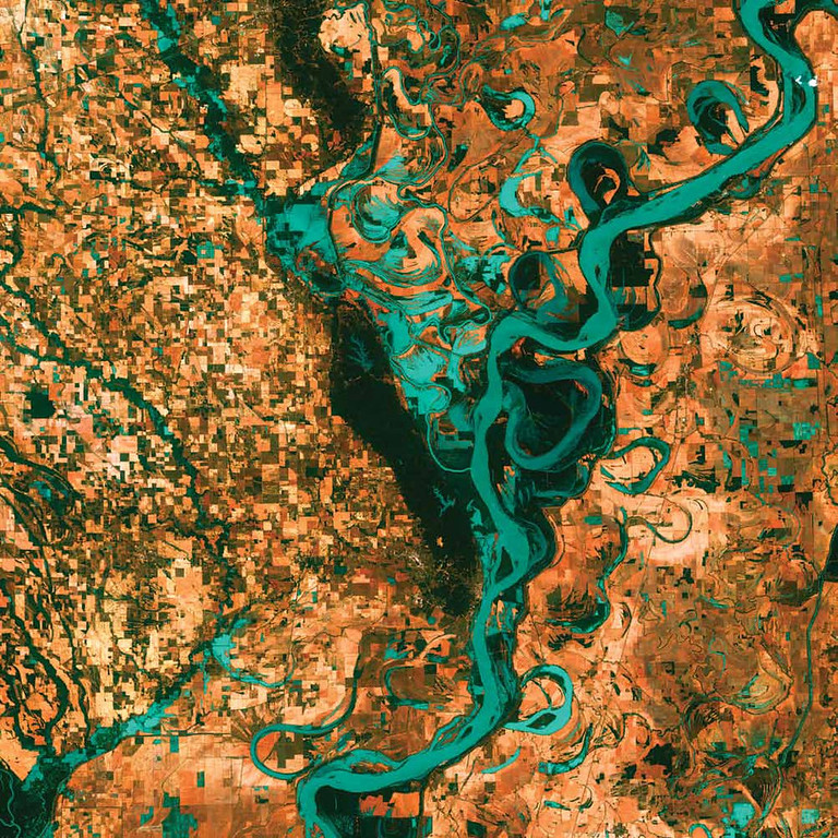. Meandering Mississippi, United States Graceful swirls and whorls of the Mississippi River encircle fields and pastures in this Landsat 7 image from 2003. Oxbow lakes and cutoffs accompany the meandering river south of Memphis, Tennessee, on the border between Arkansas and Mississippi. The mighty Mississippi is the largest river system in North America and forms the second largest watershed in the world.   NASA