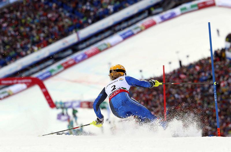 . Sweden\'s Frida Hansdotter clears a gate during the second run of the women\'s slalom, at the Alpine skiing world championships in Schladming, Austria, Saturday, Feb.16, 2013. (AP Photo/Alessandro Trovati)