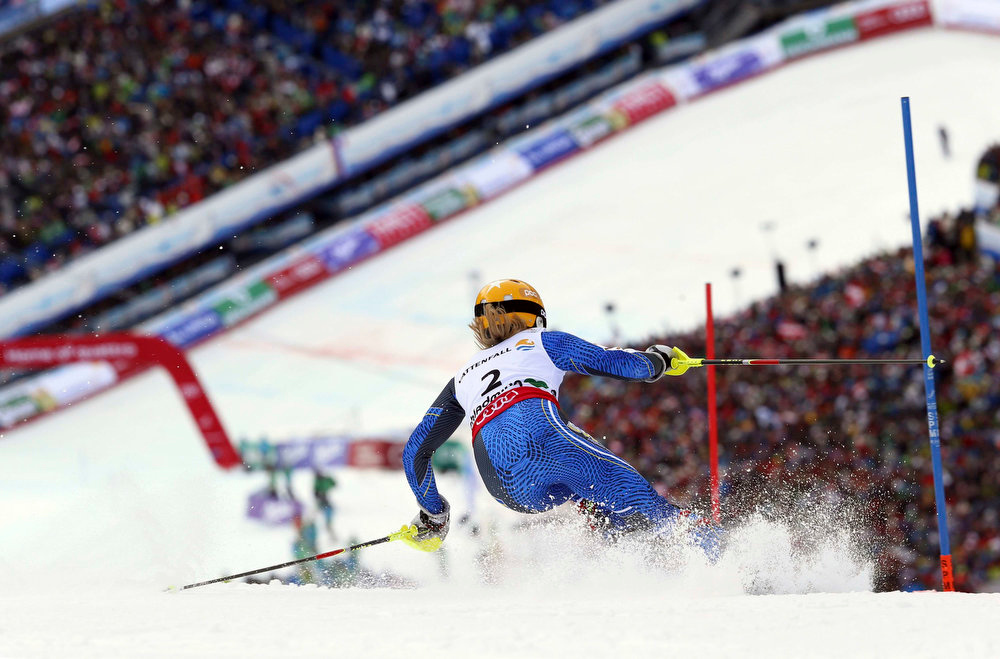 Description of . Sweden's Frida Hansdotter clears a gate during the second run of the women's slalom, at the Alpine skiing world championships in Schladming, Austria, Saturday, Feb.16, 2013. (AP Photo/Alessandro Trovati)
