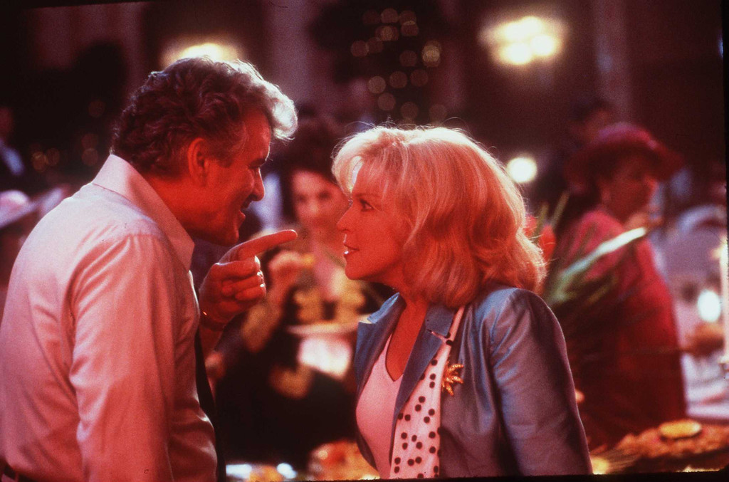 """. 1997 Bette Midler And Dennis Farina Stars In \""""That Old Feeling\"""" (Photo By Getty Images)"""