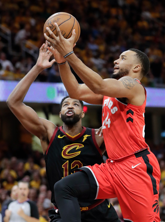 . Toronto Raptors\' Norman Powell (24) shoots against Cleveland Cavaliers\' Tristan Thompson (13) in the second half of Game 4 of an NBA basketball second-round playoff series, Monday, May 7, 2018, in Cleveland. The Cavaliers won 128-93. (AP Photo/Tony Dejak)