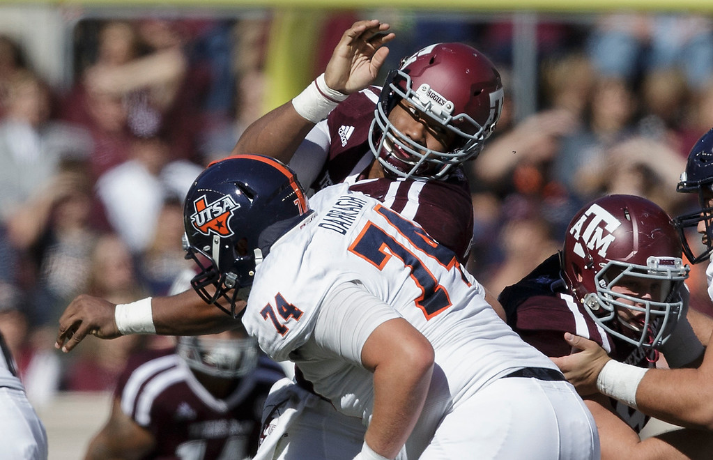 . Texas A&M defensive lineman Myles Garrett (15) makes a move around UTSA offensive tackle Reed Darragh (74) during the first quarter of an NCAA college football game Saturday, Nov. 19, 2016, in College Station, Texas. (AP Photo/Sam Craft)