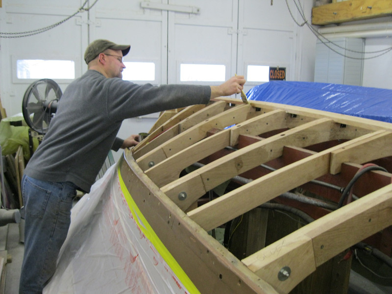 Applying epoxy to the new frames an keel.