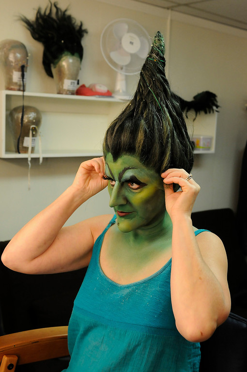 . The pointed wig is pulled on, the wild one will wait for scenes later in the play. Jacquelyn Piro Donovan is transformed into the Wicked Witch by makeup artist Michael King. The Wizard of Oz is being staged at the Pantages Theatre in Hollywood, CA. 9/25/2013. photo by (John McCoy/Los Angeles Daily News)