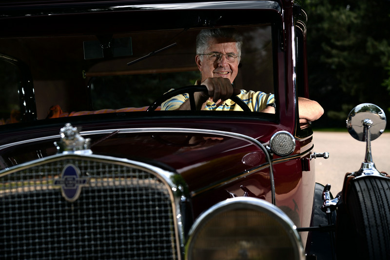 . Stringy Ervin poses with his 1931 Chevy Coach at his home. Stringy Ervin, 46-year Littleton High School swim coach, retired and was photographed on Wednesday, June 11, 2014. (Photo by AAron Ontiveroz/The Denver Post)