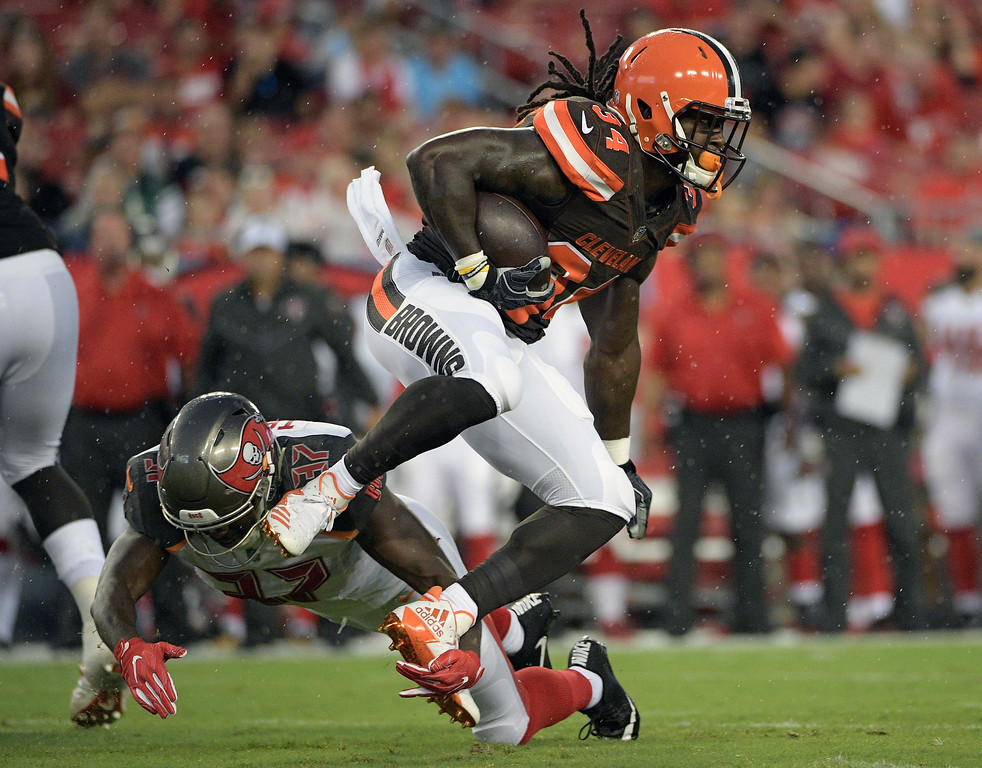 . Cleveland Browns running back Isaiah Crowell (34) eludes a tackle by Tampa Bay Buccaneers strong safety Keith Tandy (37) during the first quarter of an NFL preseason football game Saturday, Aug. 26, 2017, in Tampa, Fla. (AP Photo/Phelan Ebenhack)