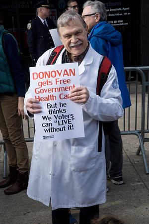 Dr. Oliver Fein, Chair of the NY Metro Chapter of Physicians For A National Health Program, joined other health professionals as the center point of today's protest at Donovan's ofice.