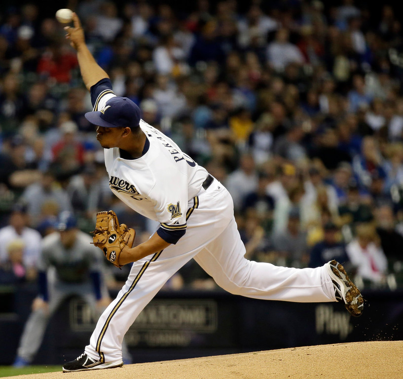 . Milwaukee Brewers starting pitcher Wily Peralta throws during the first inning of a baseball game against the Los Angeles Dodgers Wednesday, May 22, 2013, in Milwaukee. (AP Photo/Morry Gash)