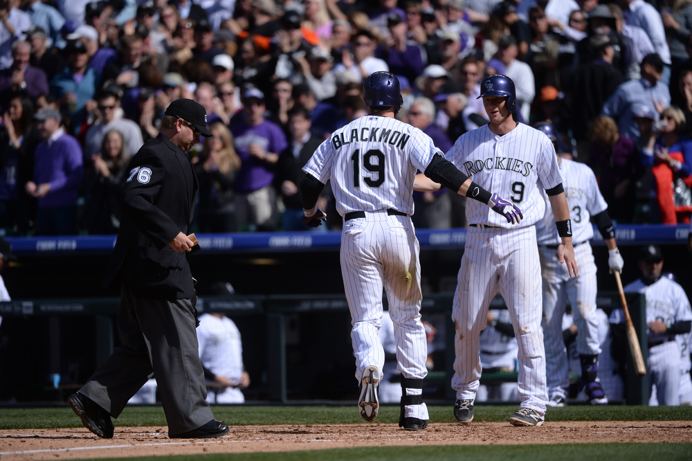 . Charlie Blackmon crosses home plate after hitting a home run during the fourth inning. The Colorado Rockies hosted the Arizona Diamondbacks in the Rockies season home opener at Coors Field in Denver, Colorado Friday, April 4, 2014. (Photo by Karl Gehring/The Denver Post)