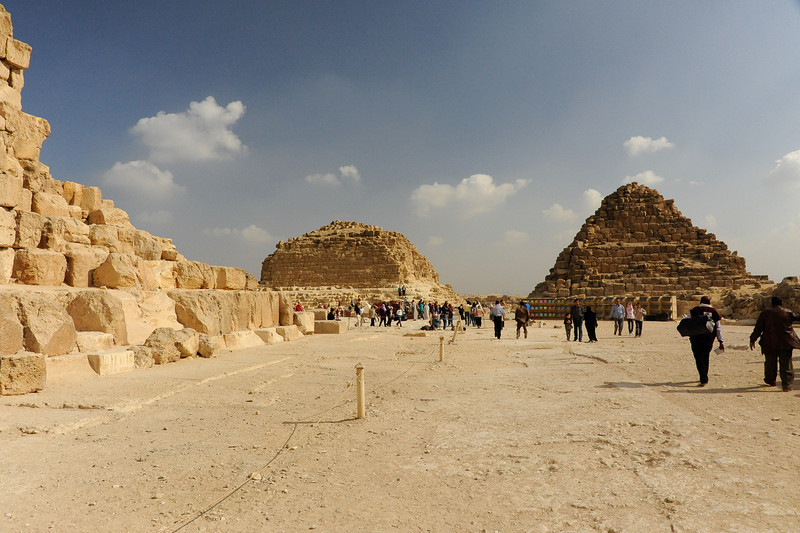 Two of three Queens' pyramids on the Giza Plateau, alongside the Great Pyramid of Khufu.