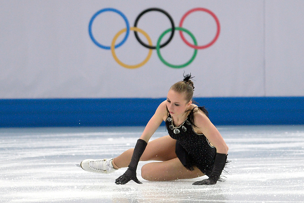 . Ukraine\'s Natalia Popova falls en route to a 53.44 during team figure skating. Sochi 2014 Winter Olympics on Saturday, February 8, 2014. (Photo by AAron Ontiveroz/The Denver Post)