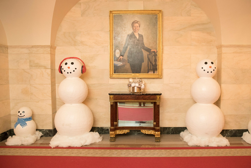 . A painting of Hillary Clinton hangs on the wall of the Lower Cross Hall, decorated with snowmen lining the corridor in the White House during a preview of the 2016 holiday decor, Tuesday, Nov. 29, 2016, in Washington. (AP Photo/Andrew Harnik)