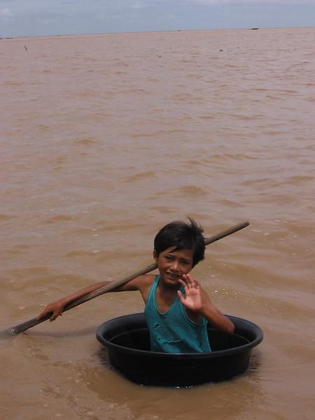 A boy paddling a bucket on Tonle Sap Lake