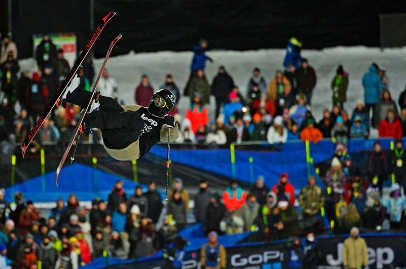 . Byron Wells flies high over the crowd during the Men\'s Ski Super Pipe Elimination at the Winter X Games in Aspen, January, 22 2014. The finals for the  Men\'s Ski Super Pipe will be held Friday night at Buttermilk Mountain. (Photo by RJ Sangosti/The Denver Post)