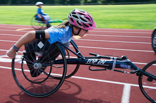 08/08/19 Wesley Bunnell | Staff Helen Newman warms up for the track and field event at the Hospital for Special Care's Ivan Lendl Adaptive Sports Camp at Berlin High School on Thursday August 9, 2019.
