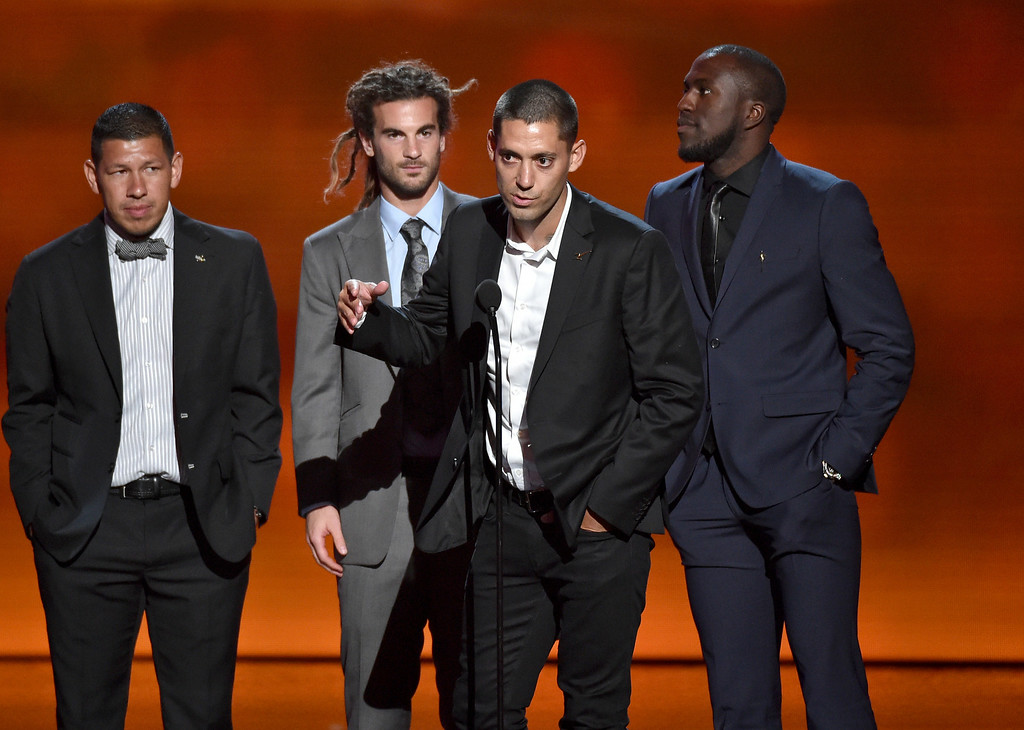 . Team captain Clint Dempsey, center, and fellow members of the U.S. men\'s soccer team accept the award for best moment, at the ESPY Awards at the Nokia Theatre on Wednesday, July 16, 2014, in Los Angeles. (Photo by John Shearer/Invision/AP)
