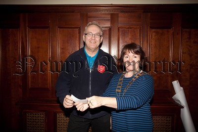 Newry Rotary Club president Frances Caherty presents a cheque to Major John Parrott from the Salvation Army. R1550023
