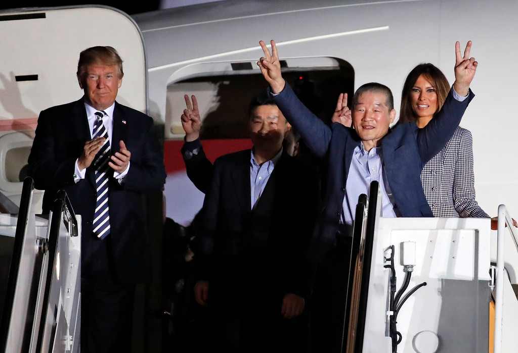 . President Donald Trump and first lady Melania Trump greet former North Korean detainees Kim Dong Chul, second right, Tony Kim, center, and Kim Hak Song, behind Tony Kim, upon their arrival, Thursday, May 10, 2018, at Andrews Air Force Base, Md. The three Korean-Americans were greeted by Trump beneath a giant American flag after they returned to the mainland U.S. early Thursday. (AP Photo/Alex Brandon)