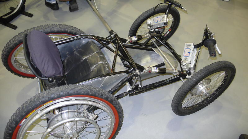 Sometimes 2 wheels doesn't work - I didn't get a chance to talk to the builder (or even get his name), but this cross country wheel chair adapts various bicycle components into its custom design.
