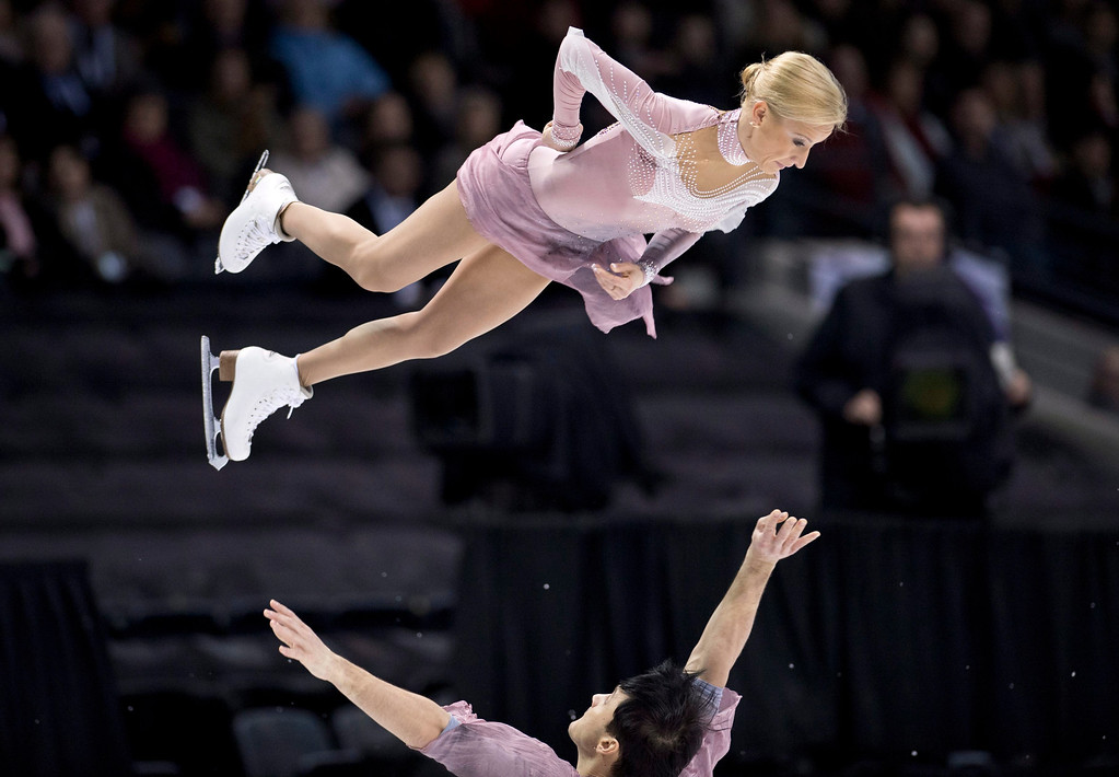 . Tatiana Volosozhar is thrown by her partner Maxim Trankov from Russia, perform their free skate program in the pairs competition at the World Figure Skating Championships Friday, March 15, 2013 in London, Ontario. (AP Photo/The Canadian Press, Paul Chiasson)