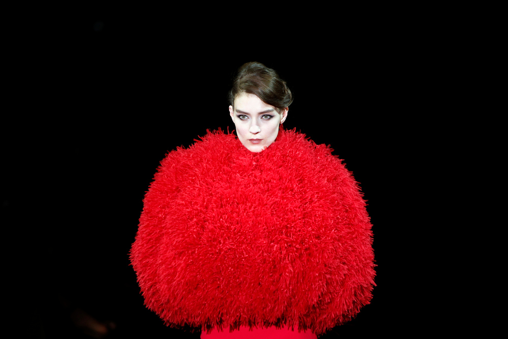 . A model wears a creation as part of the Giorgio Armani Prive Fall Winter 2014-15 Haute Couture fashion collection, presented in Paris, Tuesday, July 8, 2014. (AP Photo/Francois Mori)
