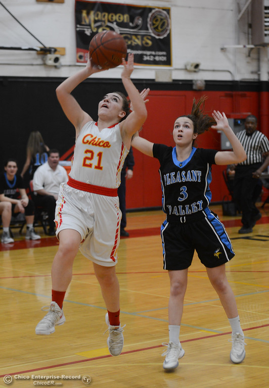 . Chico High\'s Kensey Kinney (21) goes up for a shot, followed by Pleasant Valley\'s Claire Garcia (3), Thursday, February 8, 2018, in Chico, California. (Carin Dorghalli -- Enterprise-Record)