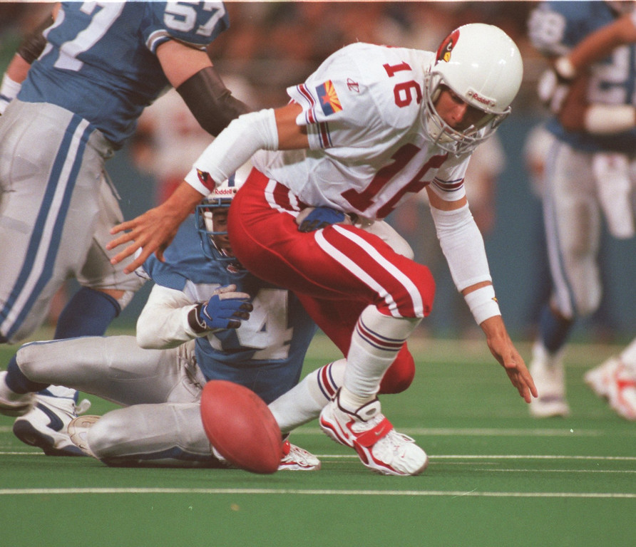. Cardinal quarterback Jake Plummer looking for the ball after being stripped by Lion cornerback Kevin Abrams. Plummer recovered his own fumble. The Arizonia Cardinals beat the Detroit Lions 17-15 in the Pontiac Silverdome.