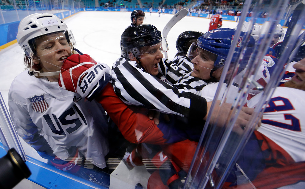 . Referees break up fight between the United States and the Czech Republic players during the first period of the quarterfinal round of the men\'s hockey game at the 2018 Winter Olympics in Gangneung, South Korea, Wednesday, Feb. 21, 2018. (AP Photo/Matt Slocum)