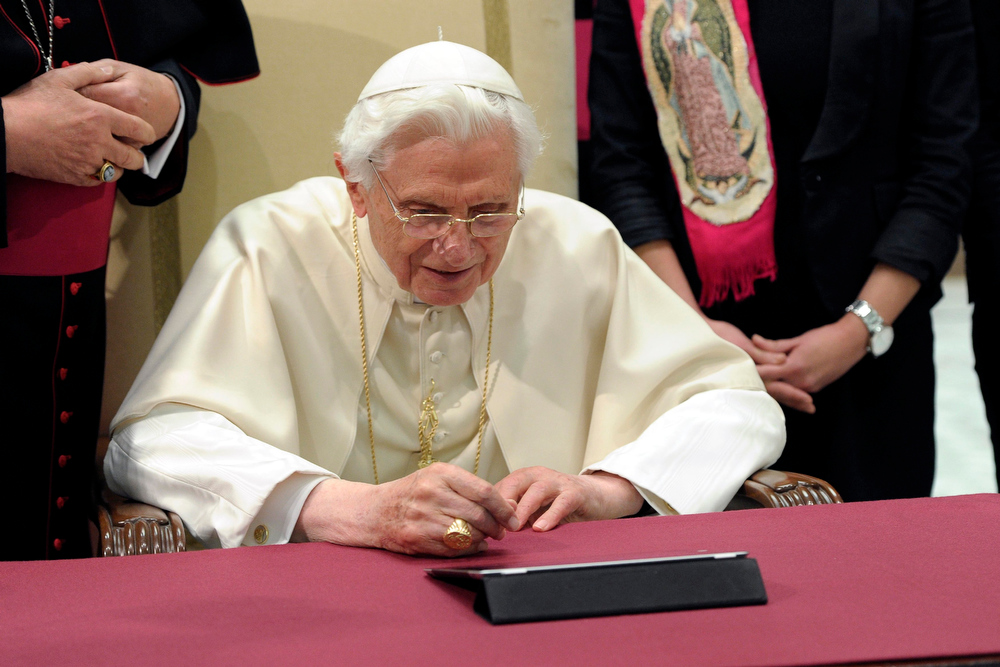 Description of . Pope Benedict XVI posts his first tweet using an iPad tablet after his Wednesday general audience in Paul VI's Hall at the Vatican December 12, 2012. REUTERS/Osservatore Romano