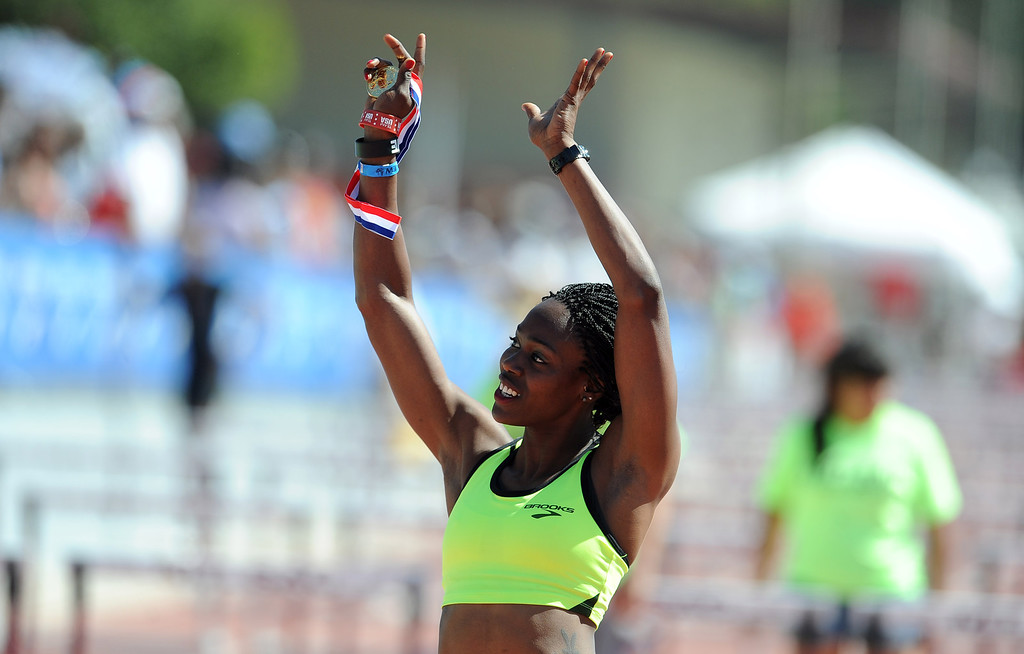 . Yvette Lewis of Brooks waves to the crowd after winning the 100 meter hurdles invitational elite during the Mt. SAC Relays in Hilmer Lodge Stadium on the campus of Mt. San Antonio College on Saturday, April 20, 2012 in Walnut, Calif.    (Keith Birmingham/Pasadena Star-News)