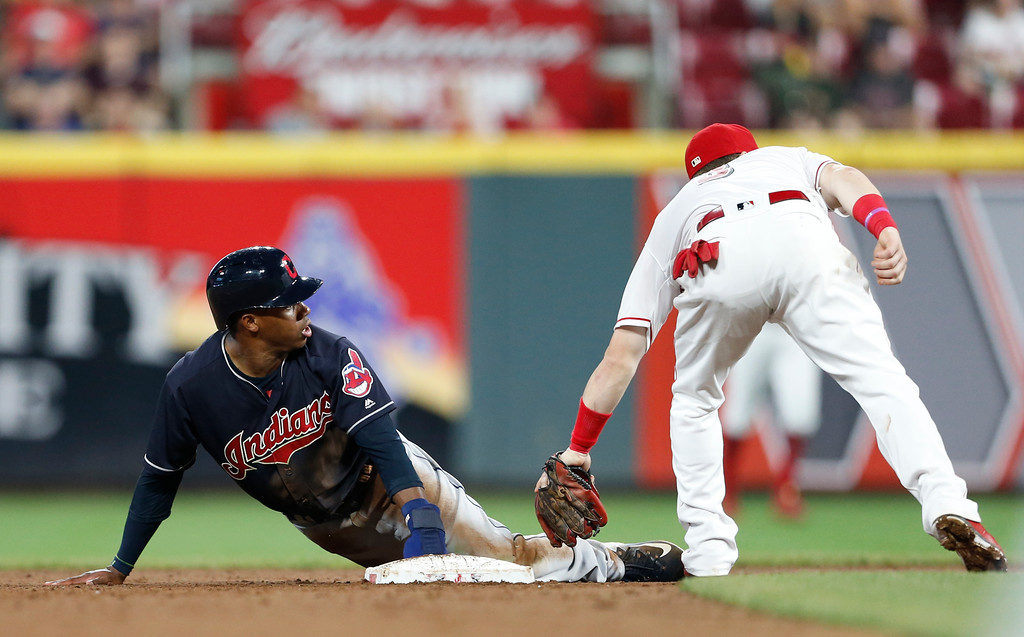 . Cleveland Indians\' Greg Allen, left, is out at second base on a steal attempt after the tag by Cincinnati Reds second baseman Scooter Gennett during the sixth inning of a baseball game Wednesday, Aug. 15, 2018, in Cincinnati. (AP Photo/Gary Landers)