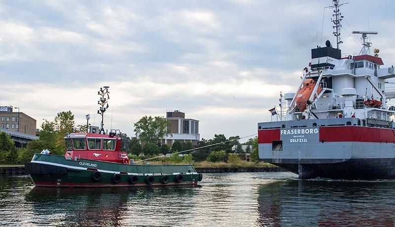 . Submitted by Roger W. Fair <br> A tugboat guides the freighter Fraserborg into the port of Lorain on Sept. 18, 2017. The vessel is owned by Royal Wagenborg, an international shipping company with a fleet of 173 vessels. It is 154.6 meters, or about 507 feet, in length, and 17.2 meters, or about 56 feet, wide. On Sept. 19 it appeared the vessel was docked while being loaded with aggregate materials in Lorain.