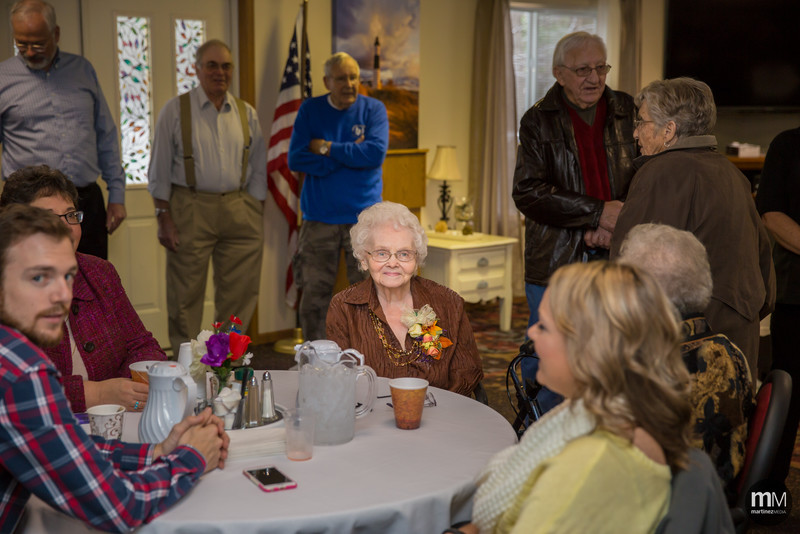 A week ago we had the opportunity to capture a 90th birthday party (that's right, 90!). In addition to some family portraits, we also captured some candids of the party.  Out of the entire set of photos, this is the one that struck us the most. It's amazing to see such a glow from a woman that's lived many years surrounded by so many people that love her. Happy 90th birthday, and here's to many more!