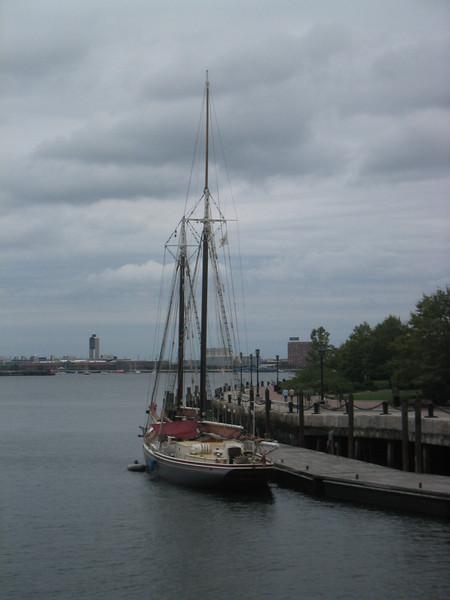 Sailboat by the HarborWalk at the Fan Pier. Boston