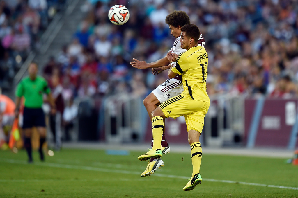. Chris Klute #15 of the Colorado Rapids and Hector Jimenez #12 of the Columbus Crew go up to head the ball during an MLS game at Dick\'s Sporting Goods Park on July 4, 2014, in Commerce City, Colorado. The Rapids and Crew finished in a 1-1 draw. (Photo by Daniel Petty/The Denver Post)
