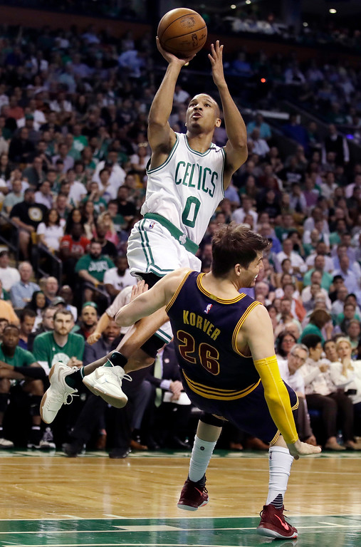 . Boston Celtics guard Avery Bradley drives against Cleveland Cavaliers guard Kyle Korver (26) during the first quarter of Game 1 of the NBA basketball Eastern Conference finals, Wednesday, May 17, 2017, in Boston. (AP Photo/Charles Krupa)