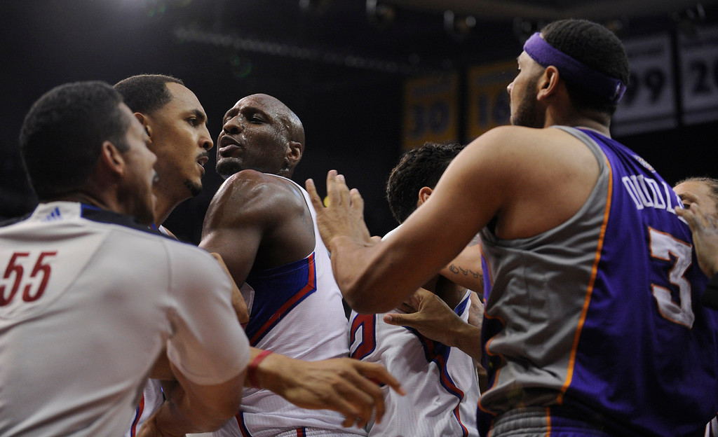 . Lamar Odom, center, tries to keep distance between  Clippers Ryan Hollins and Phoenix Jared Dudley at Staples Center in Los Angeles, CA 4/3/2013 (John McCoy/Los Angeles Daily News)