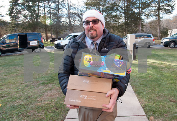 12/20/17 Wesley Bunnell | Staff Papas Dodge delivered donations to the Prudence Crandall Center on Wednesday afternoon as part of its fill the van drive held over the last several weeks. Household items were collected at the dealership such as bedding, clothes, small appliances and other household necessities clients of the center who are victims of domestic violence. General Manager Sean Lawlor carries donations into the center.
