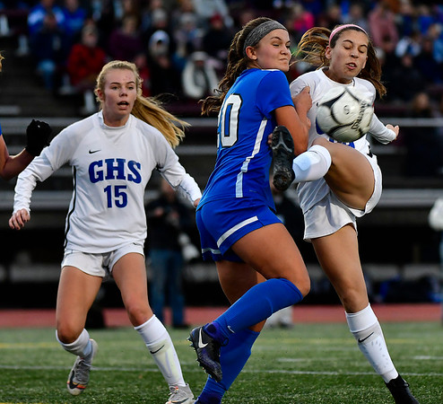 11/23/2019 Mike Orazzi | StaffrSouthington High Schools Katherine Crouse (20) and Glastonbury's Alexandra Bedard (29) during the Class LL Girls State Soccer Tournament at Veterans Stadium in New Britain Saturday evening. Glastonbury won 1-0. r