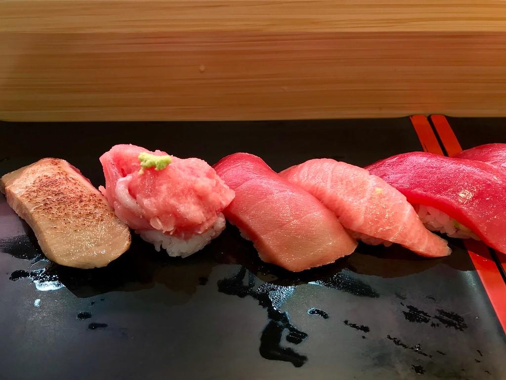 5 kinds of tuna nigiri - grilled fatty tuna, head meat (zuniku), medium-fatty tuna (chutoro), fatty tuna (otoro), lean tuna (akami)