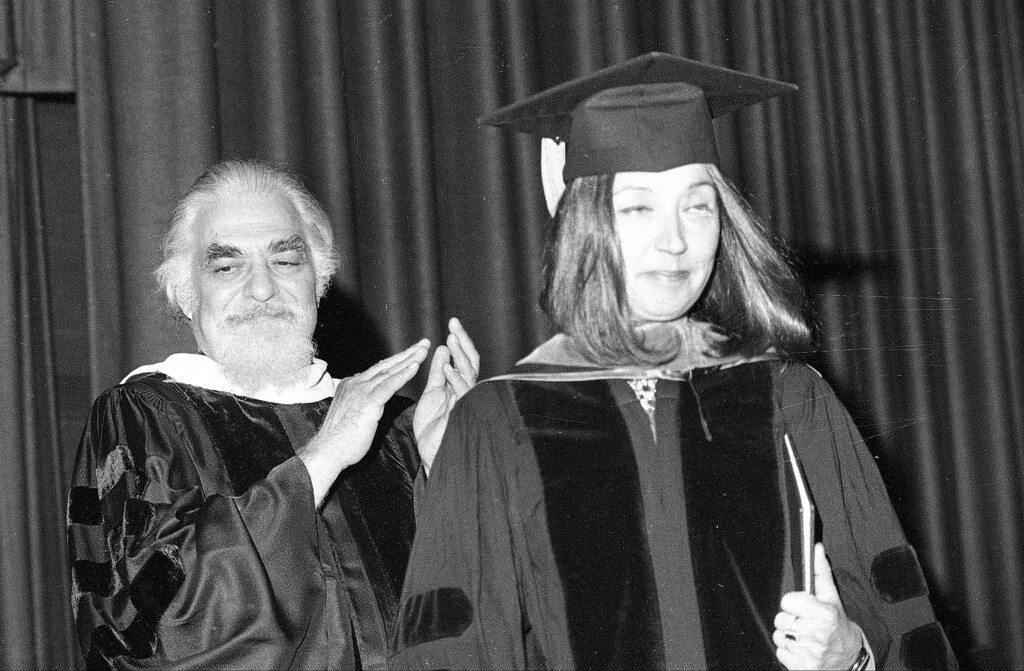 . Mirren Alexandroff, president of Columbia College Chicago, applauds after Oriana Fallaci receives an Honorary Doctor of Letters degree during the 87th commencement at Columbia College Chicago, Ill., Friday, June 11, 1977. The award winning-author and journalist, a native of Florence, Italy, is among five recipients as a special tribute to their individual talents, creativity and spirits.  (AP Photo)
