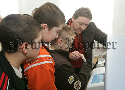 Pupils from St Patrick's Cullyhanna  get a tour of South Armaghs Water Treatment plant, Pictuerd with the pupils is Gerry Laverty tour operator at the plant in Crossmaglen. 07W8N13