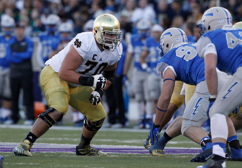 . In this Oct. 26, 2013, file photo, Notre Dame offensive tackle Zack Martin looks to block against Air Force during the third quarter of  an NCAA football game at the Air Force Academy, Colo. Martin was selected in the first round, 16th overall, by the Dallas Cowboys in the NFL draft on Thursday, May 8, 2014. (AP Photo/David Zalubowski)