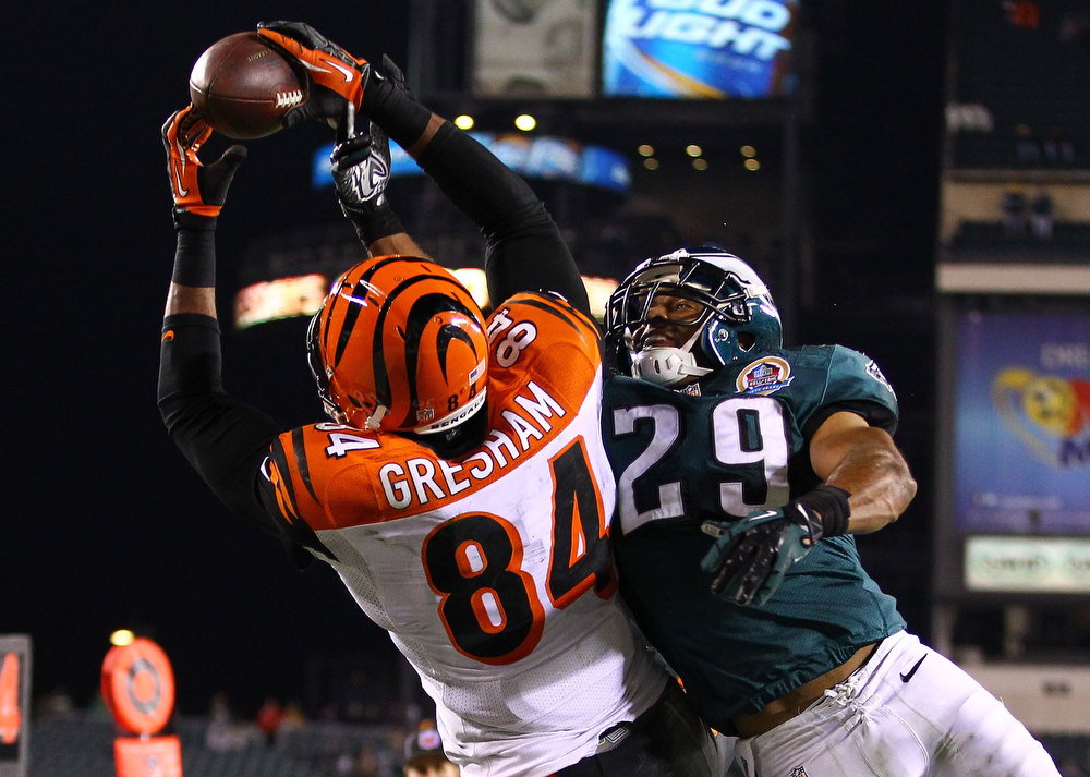 . Jermaine Gresham #84 of the Cincinnati Bengals makes a catch against  Nate Allen #29 of the Philadelphia Eagles during their game at Lincoln Financial Field on December 13, 2012 in Philadelphia, Pennsylvania.  (Photo by Al Bello/Getty Images)