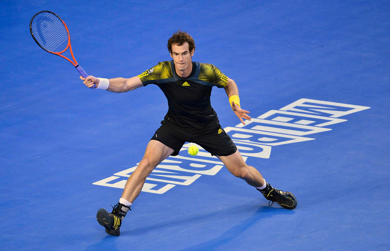 . Andy Murray of Britain hits a return to Roger Federer of Switzerland during their men\'s singles semi-final match at the Australian Open tennis tournament in Melbourne January 25, 2013. REUTERS/Toby Melville