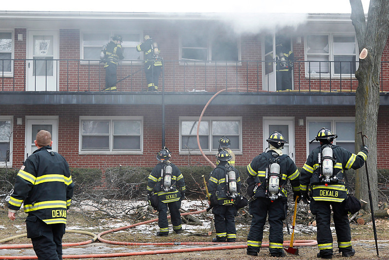 DeKalb Firefighters respond to a fire call at the 921 Normal Road Apartment Complex in DeKalb on February 11, 2013. The fire completely destroyed apartment #208 which remains un-inhabitable due to a fire caused by an out-dated water heater in the complex.